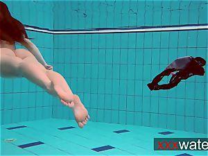 Pierced teenage swimming