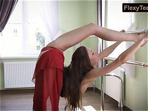 mischievous gymnast Inessa in a crimson sundress