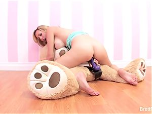 Brett Rossi plays with a rammed bear's strap-on dildo