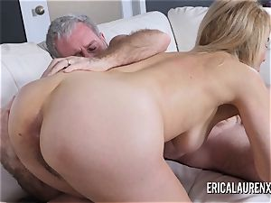 Mature Erica Lauren wraps her lips around a hefty weenie