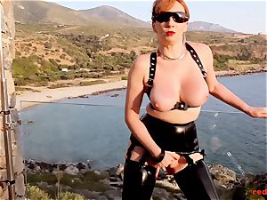 brit red-haired milking outside on the balcony