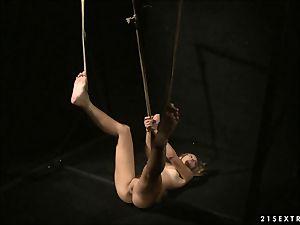 Mandy Bright makes a tied stunner deepthroat a hitachi