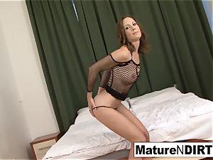 dark haired cougar masturbates before taking a bbc