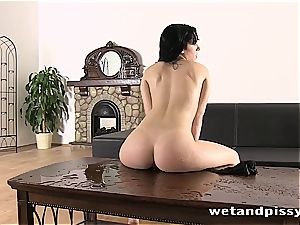 black haired sweetie in pantyhose pissing