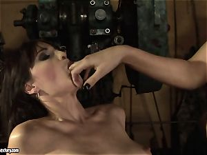 Mandy Bright fingerblasting a steaming nymph in a machine shop